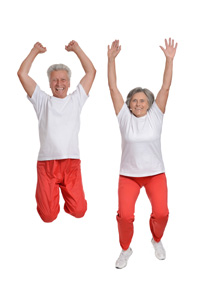 Older Couple Jumping For Joy